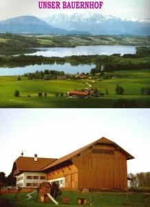 Unser Bauernhof mit 3 Seen und den Bergen im Hintergrund
